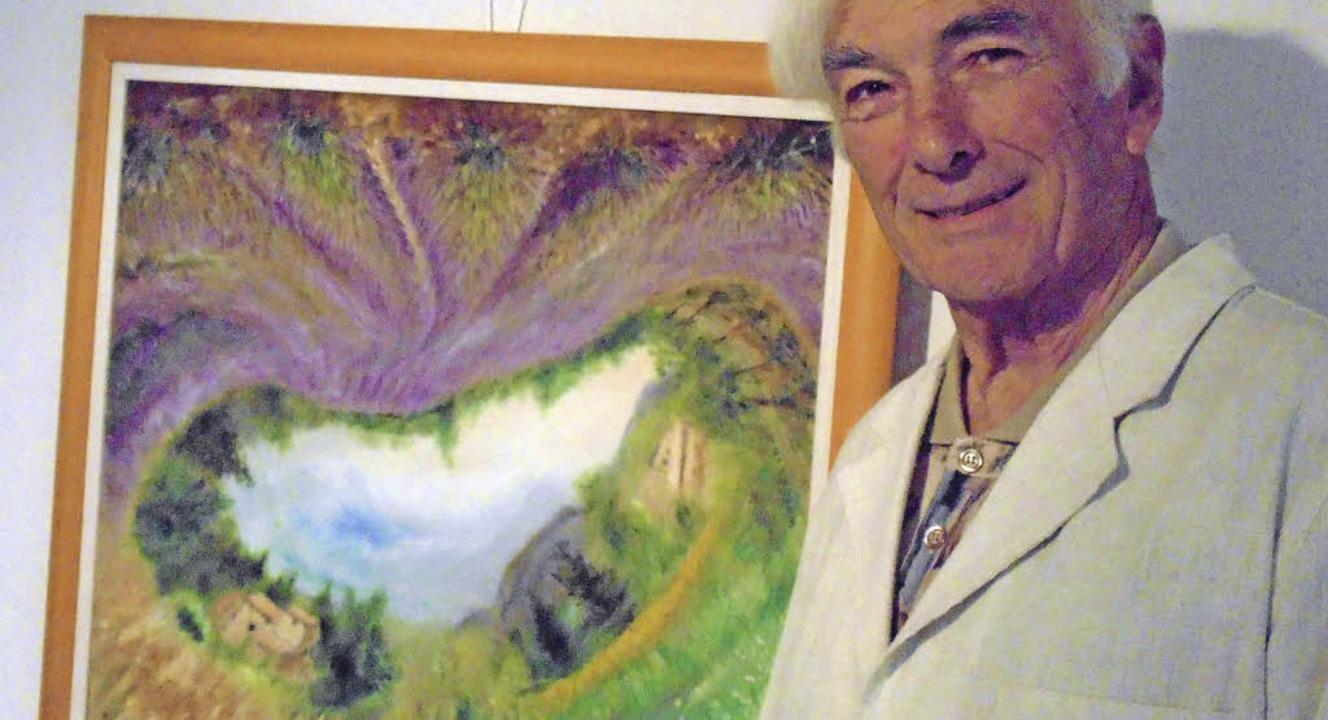 Der Künstler und sein Werk: Marc Wallerand mit einem seiner Rundbilder     Foto: Michael Gottstein