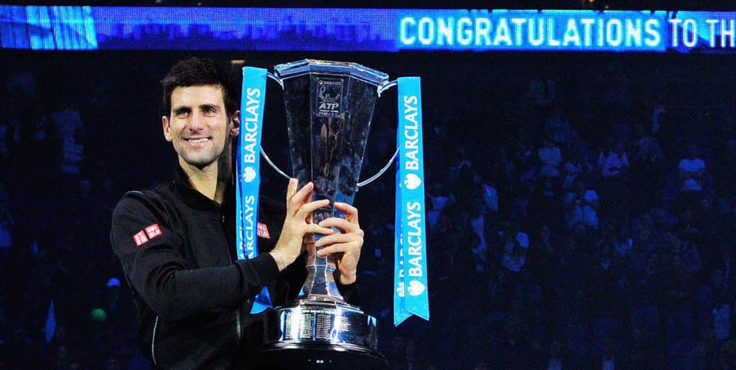 Gratulation: Das Tennisjahr nimmt für ...dem Sieg in London das erhoffte Ende.   | Foto: afp