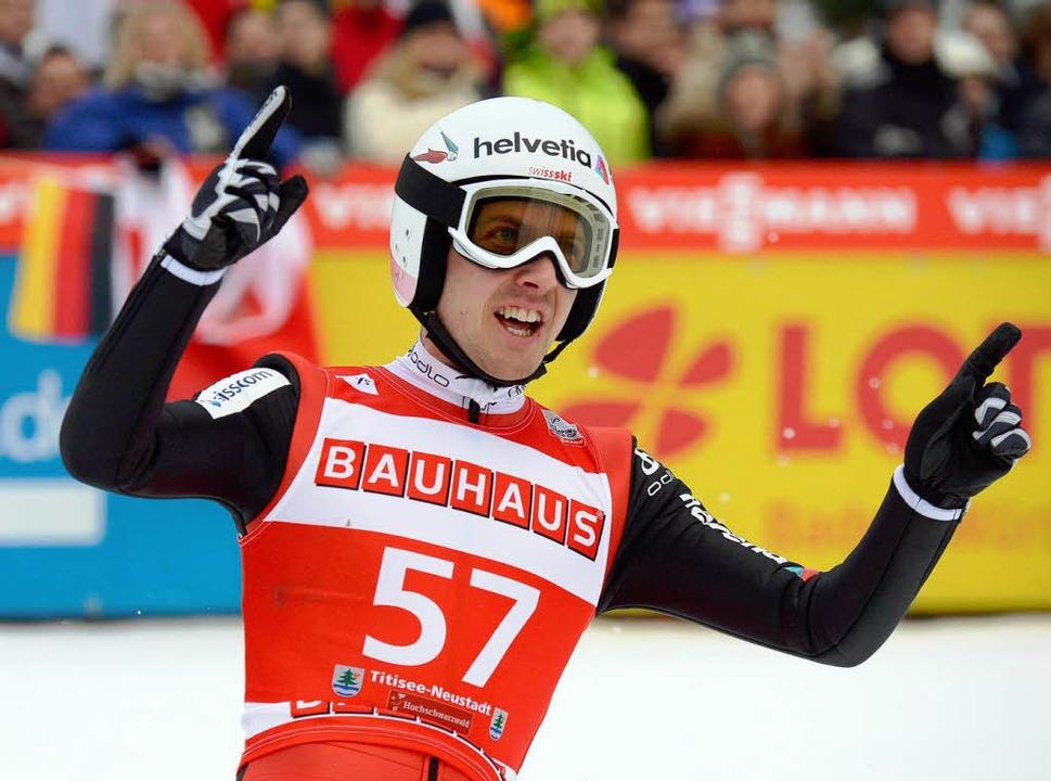 Zweiter und Dritter in Neustadt: Simon Amann aus der Schweiz  | Foto: dpa
