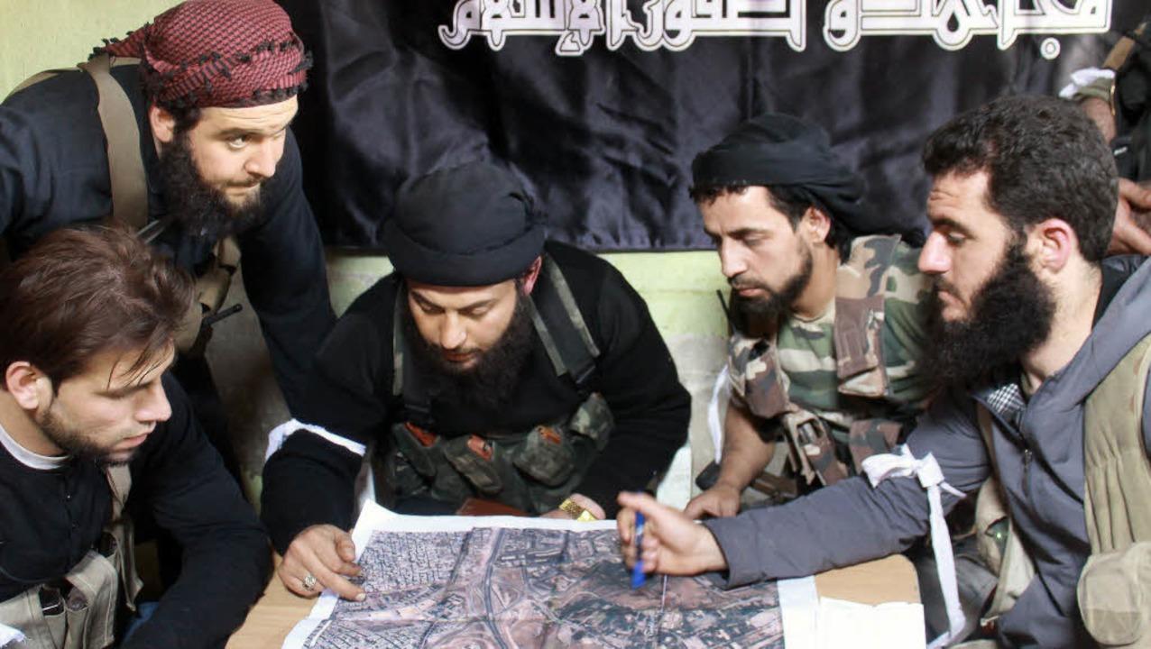 Lagebesprechung islamistischer Rebellen in Aleppo  | Foto: AFP