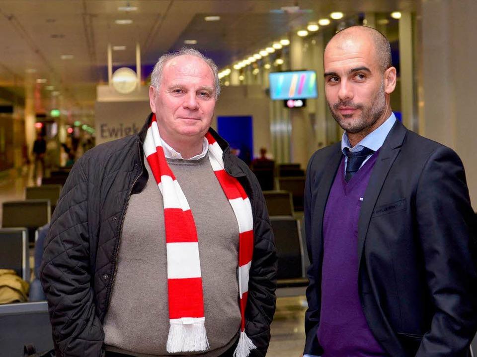 Ein Herz und eine Seele? Uli Hoeneß (links) und Trainer Pep Guardiola  | Foto: Verwendung weltweit, usage worldwide
