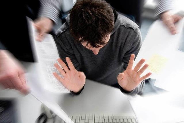 Lärm in Großraumbüros sorgt für Stress