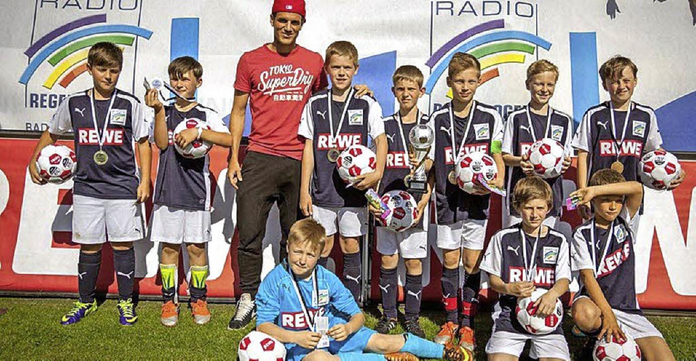 Die E-Junioren der SG Forchheim Weiswe...en Teams von meist größeren Vereinen.   | Foto: Privat