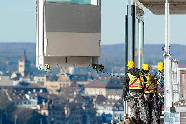 Lohndumping beim Bau des Roche-Turms durch deutsche Firma