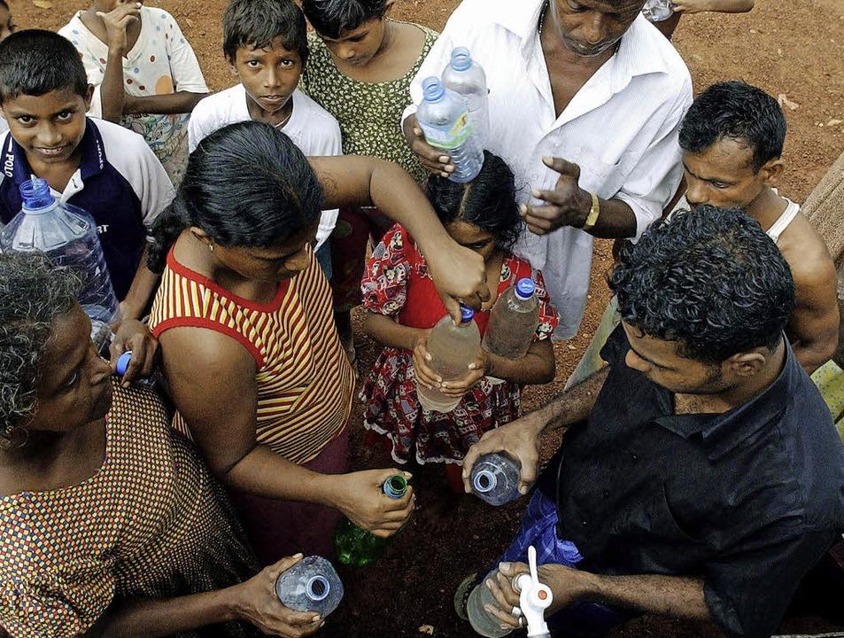 In Sri Lanka Luxus: sauberes Trinkwasser  | Foto: AFP