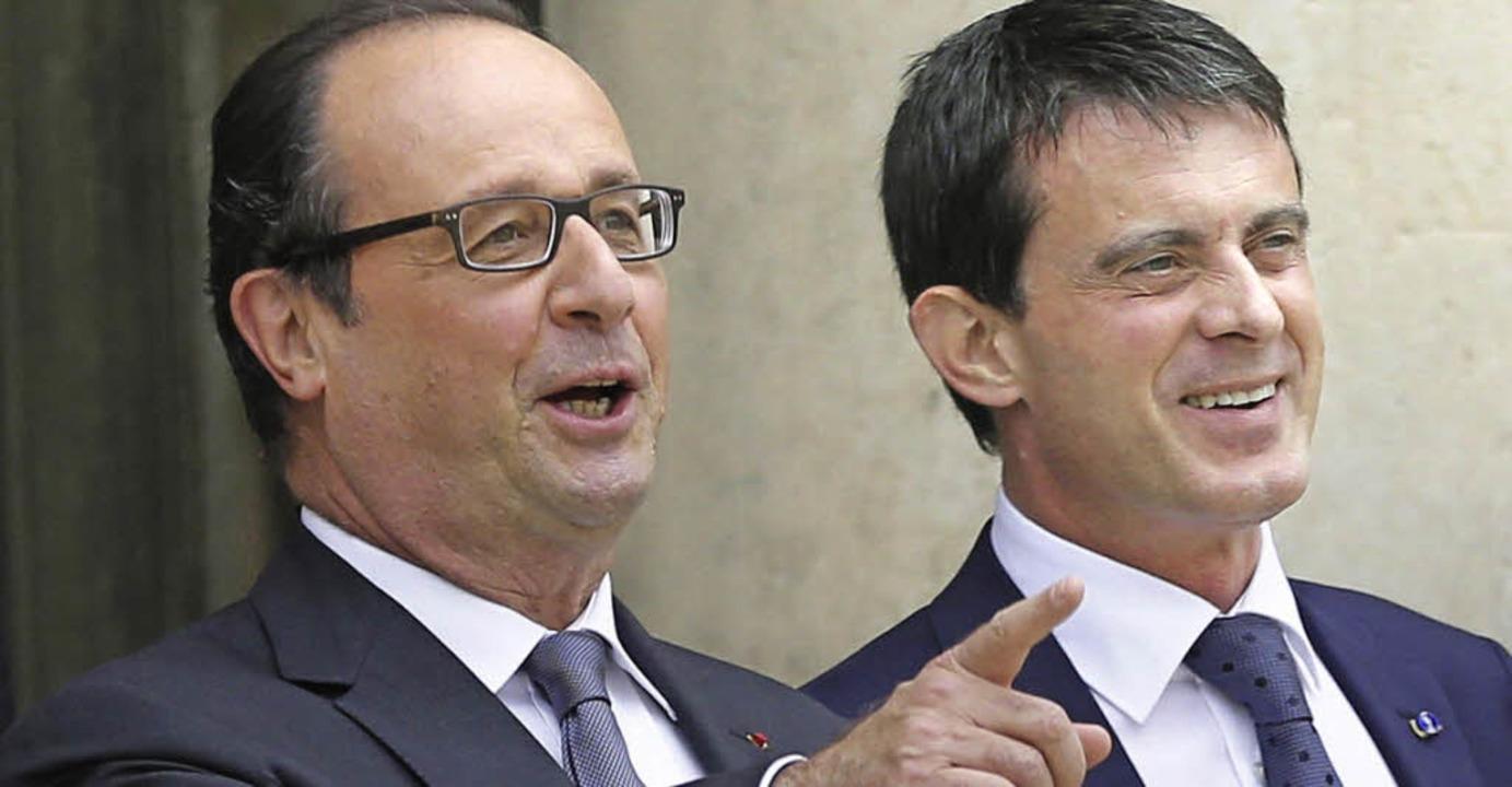 Präsident Hollande (links) und Premier Manuel Valls  | Foto: DPA