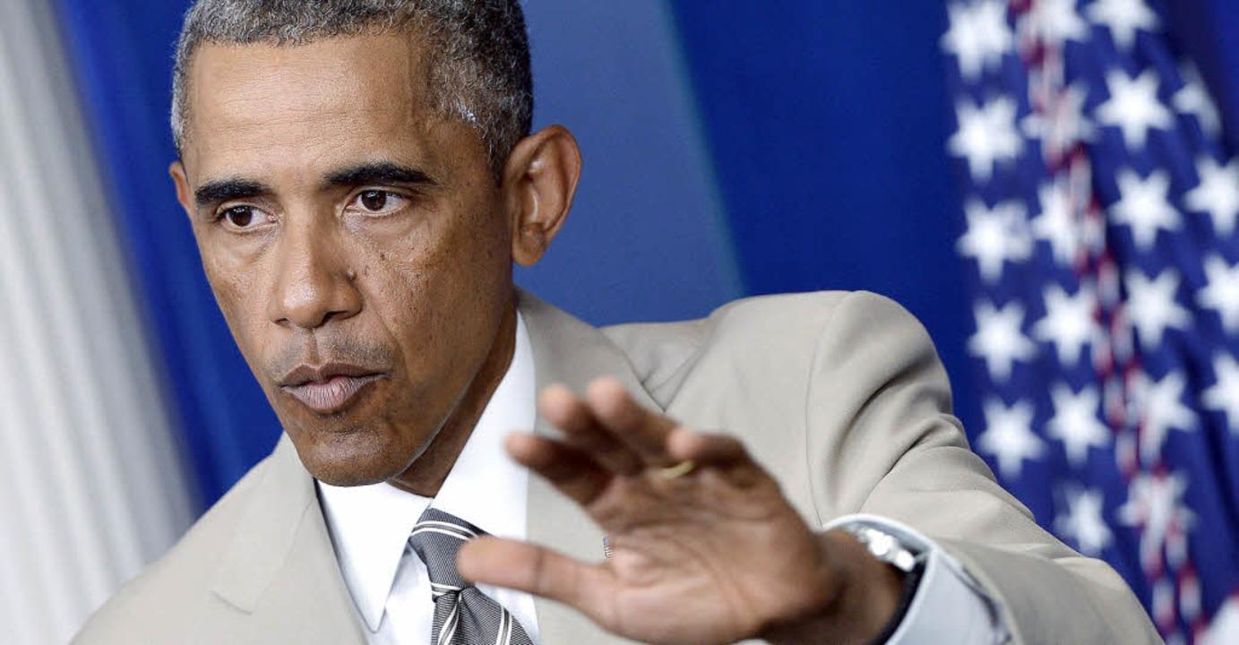 Der  Sommeranzug von Barack Obama bewe...sten (beinahe) mehr als dessen Worte.   | Foto: DPA