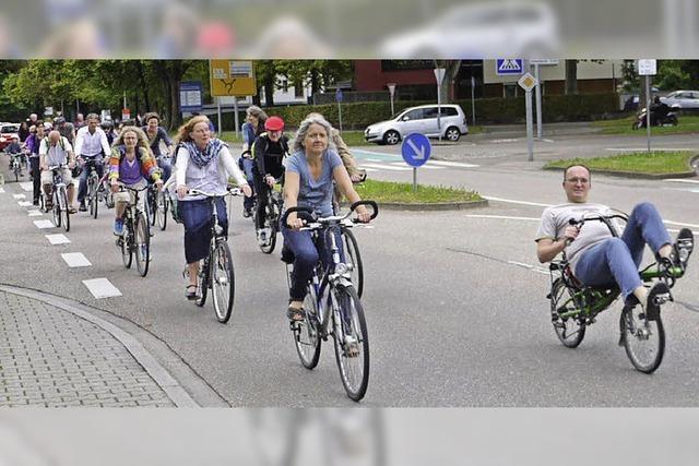 Petitionieren und Radfahren für ein besseres Klima