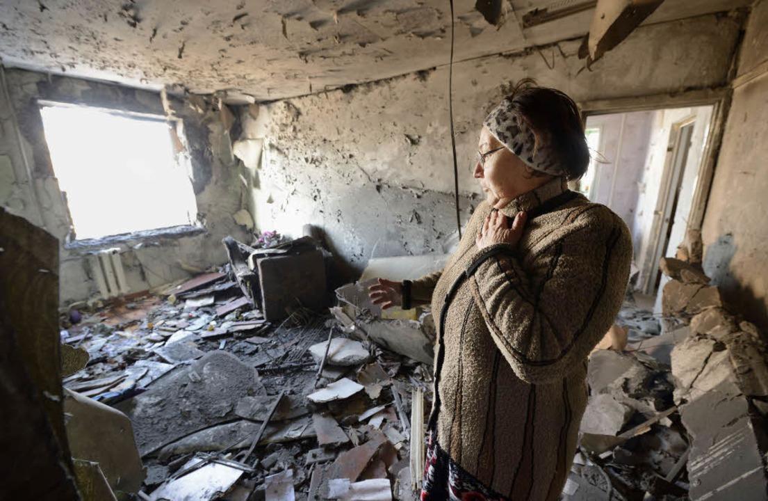 Ein Angriff russischer Separatistenin Donezk  | Foto: AFP