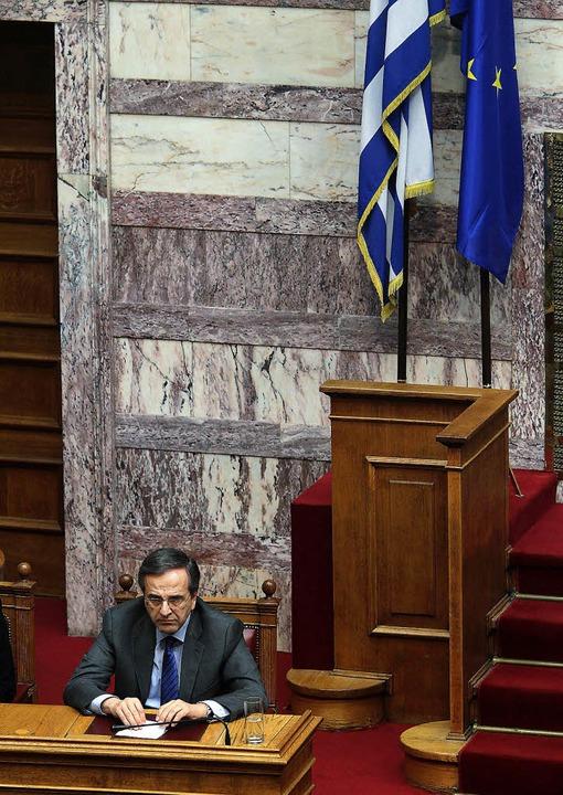 Für  Griechenlands Premier Antonis Sam...uch  um die eigene politische Zukunft.  | Foto: dpa
