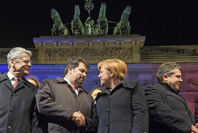 Mahnwache in Berlin.   | Foto: dpa