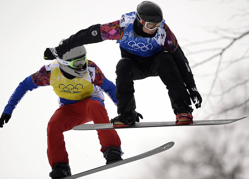 Paul Berg (rechts), der beste Snowboar...erspielen im russischen Sotschi 2014.   | Foto: DPA