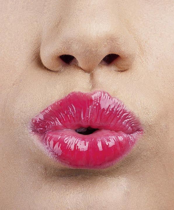 Zieht die Blicke auf sich: Ein roter Mund    Foto: Lubos Chlubny - Fotolia