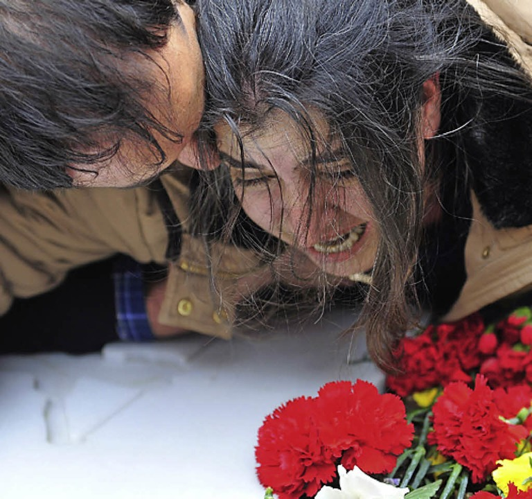 Die Mutter am Grab  | Foto: AFP