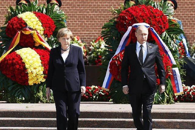 Reue und Rüge: Merkel in Moskau