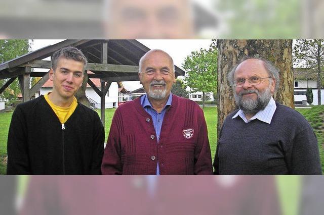 Drei Männer geben den Takt an
