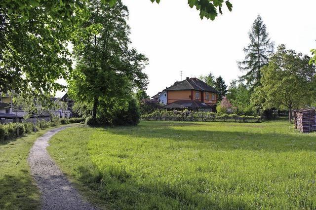 Pläne für drei villenartige Häuser