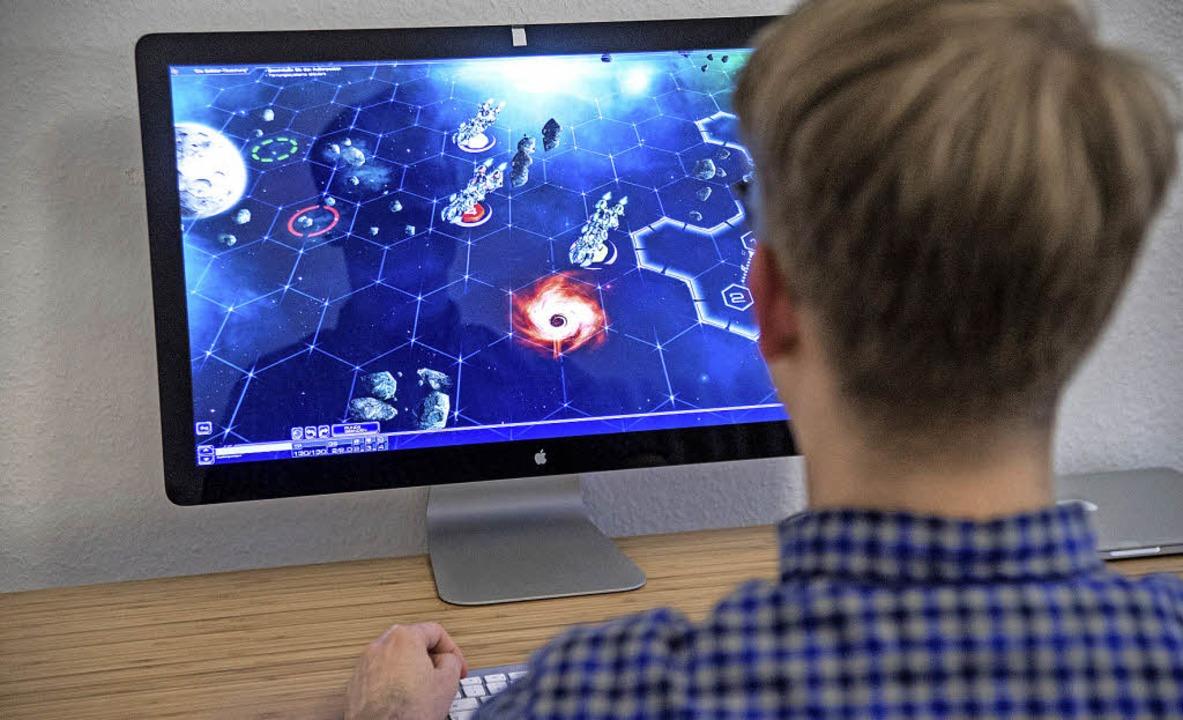 Computerspiele faszinieren vor allem J... Manchmal aber auch ein wenig zu viel.    Foto: DPA
