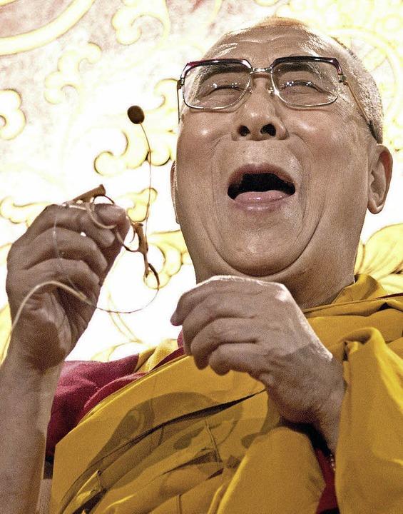 Buddhist mit guter Laune: der Dalai Lama im August 2014 in Hamburg    | Foto: dpa/Bigi Alt