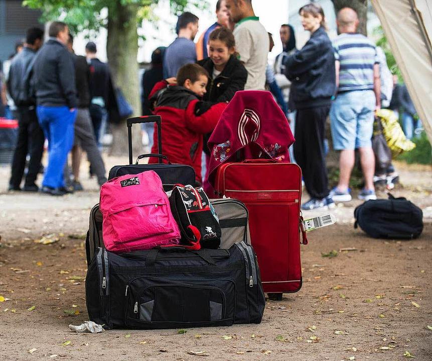 Die Planungen für ein Flüchtlingswohnh...sichte Gefühle in der Bevölkerung aus.  | Foto: dpa