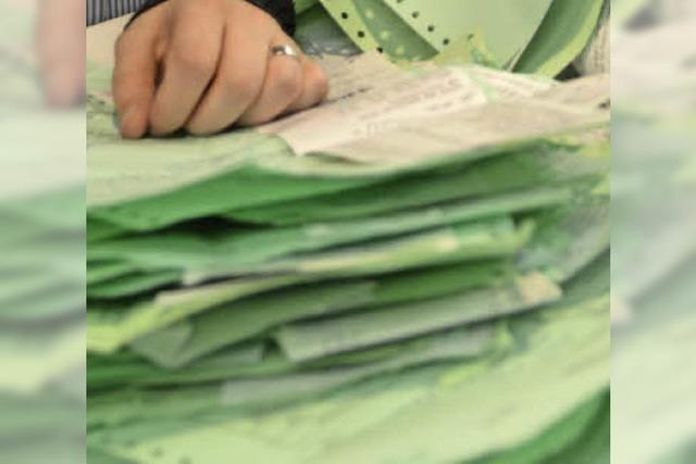 Grüne Zettel am Fließband