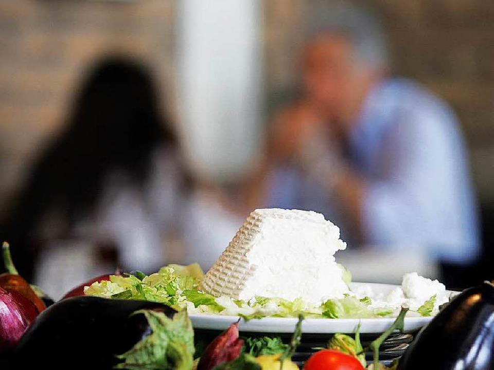 Regionales auf dem Tisch: Heimischer R...e in einem Slow-Food-Restaurant in Rom  | Foto: AFP