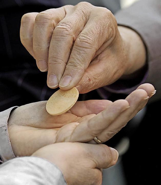 Hostien gibt es inzwischen auch glutenreduziert.   | Foto: dpa