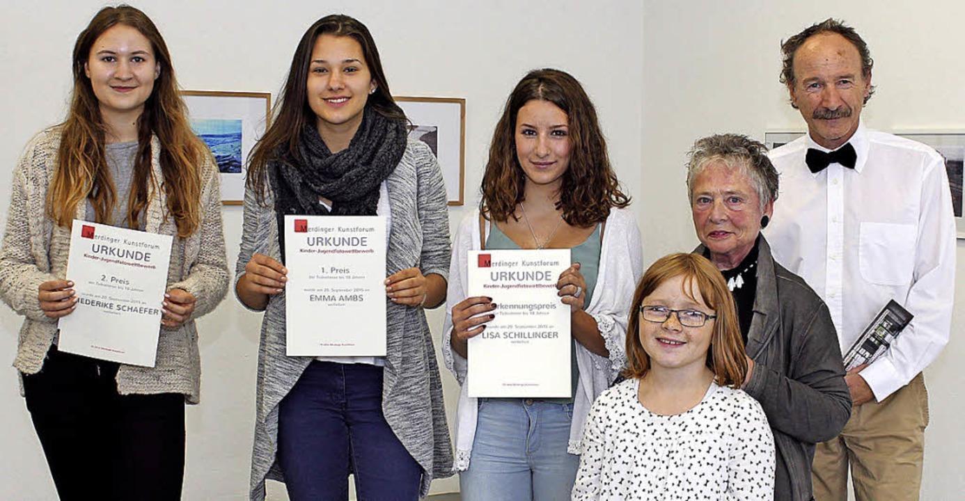 Die jungen Sieger des Fotowettbewerbs ...-Mitgliedern; rechts: ein Siegerbild.   | Foto: Mario Schöneberg