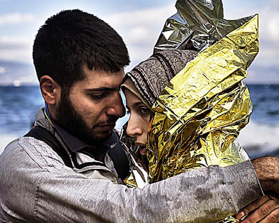 Syrische Flüchtlinge auf Lesbos. Regim... dass nun noch mehr Menschen fliehen.     Foto: afp