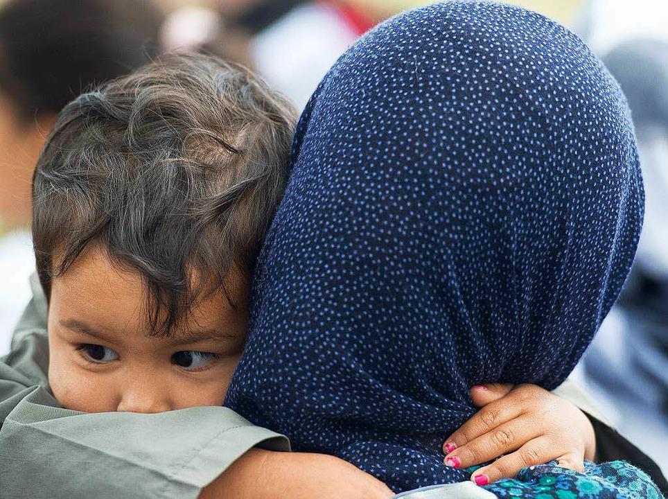 Wo erhalten Flüchtlinge im Landkreis Lörrach Unterstützung?  | Foto: dpa