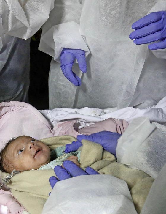 Unterernährt und unterkühlt:  Das  Bab...r Flüchtlinge in Biberach untersucht.   | Foto: dpa