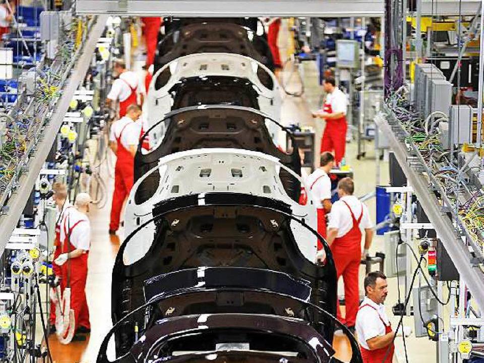 Früher ein beliebtes Mittel zur Steige...ließband, hier bei Porsche in Leipzig   | Foto: dpa