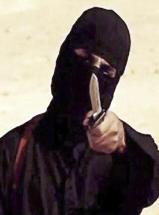"Der Screenshot eines IS-Videos zeigt ""Jihadi John"".   | Foto: DPA"