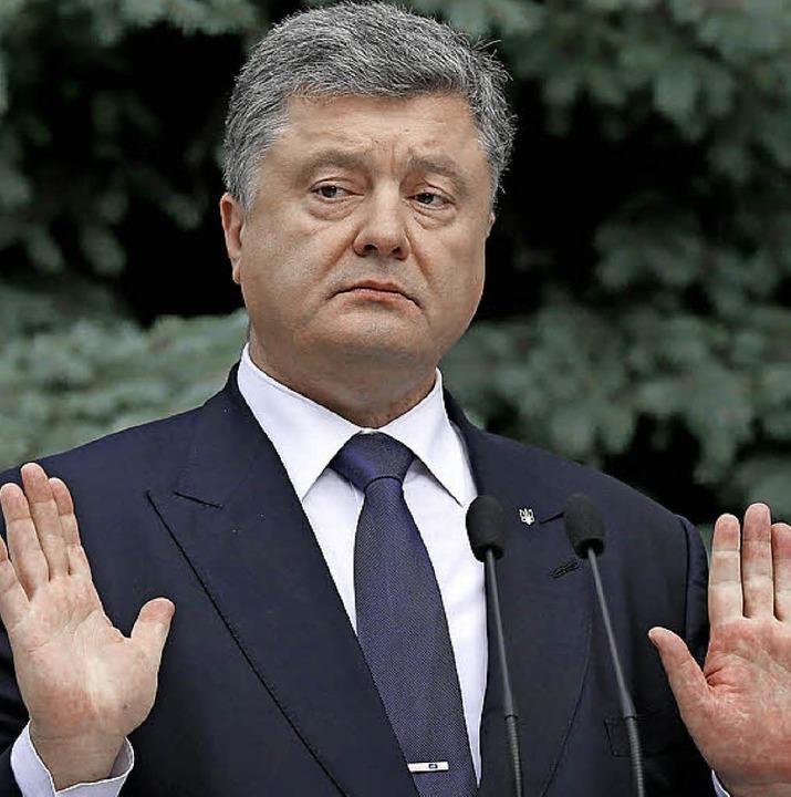 Ist im Amt reicher geworden: Präsident Poroschenko   | Foto: dpa