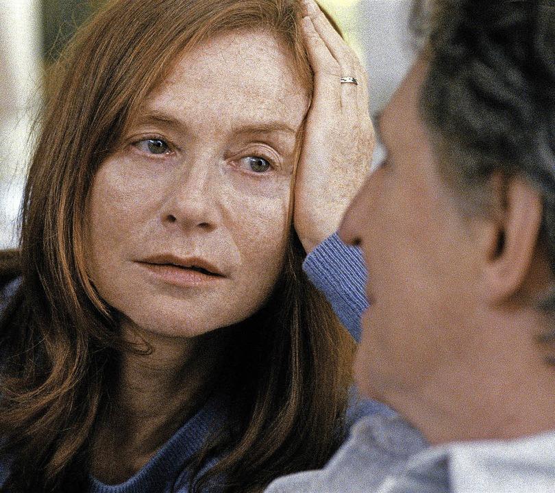 Isabelle Huppert spielt die  Kriegsfot...,  Gabriel Byrne  ihren Ehemann Gene.     Foto: dpa