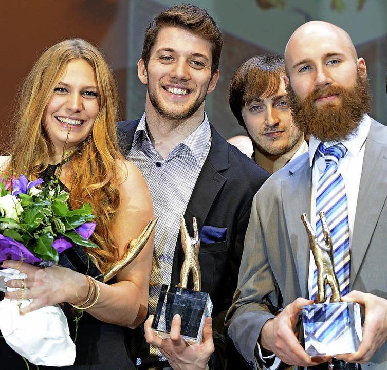 Die meisten Stimmen (von links): die S...terer sowie EHC-Kapitän Philipp Rießle  | Foto: Rita Eggstein