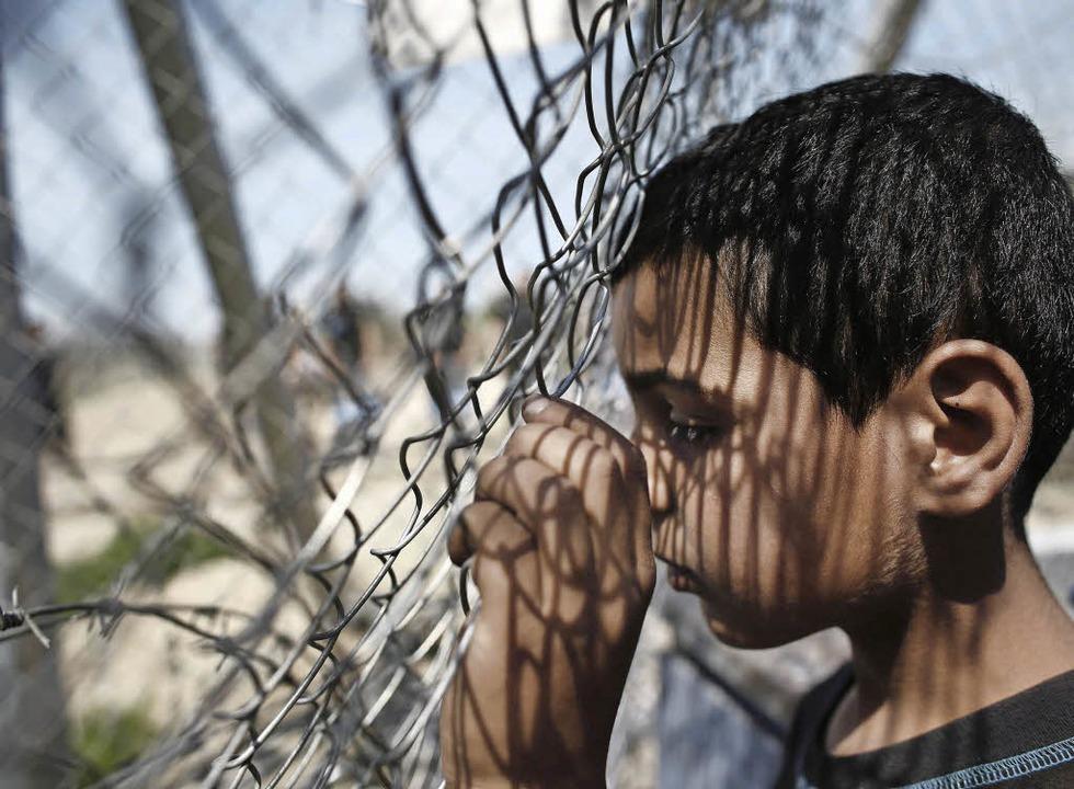 Flüchtlingskind in Idomeni     Foto: DPA