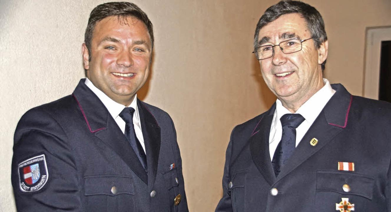 Christian Burkhard (links) ist neuer K...d wurde zum Ehrenkommandanten ernannt.  | Foto: Ilona Hüge