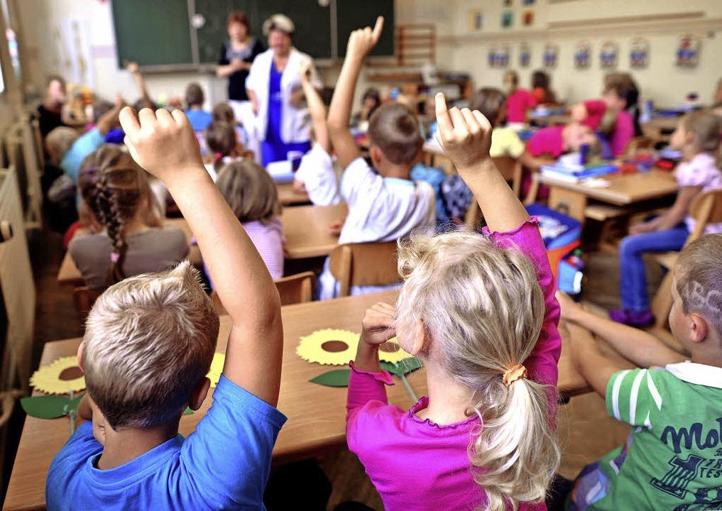 """Als """"Ort zum Leben und Lernen&#8...desregierung die Ganztagsgrundschule.     Foto: DPA"""