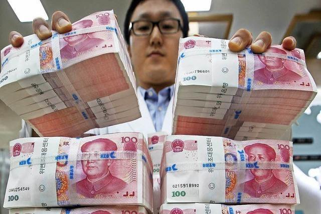 China kauft Fußballklubs, Goldhändler und Roboterbauer