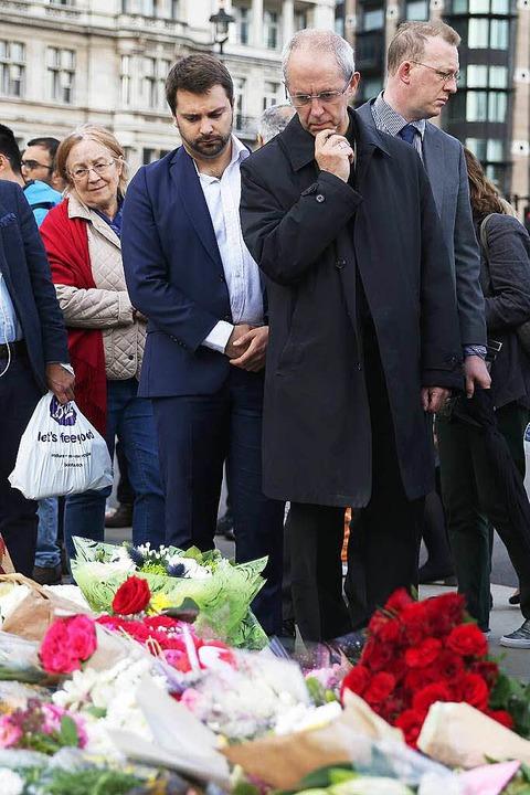 Erzbischof Justin Welby (r.) bei der Trauerfeier für die ermordete Jo Cox    Foto: AFP