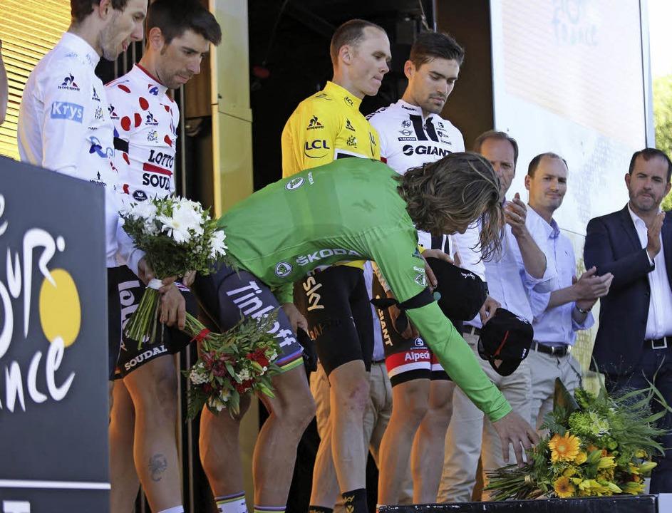 Die Träger der speziellen Trikots lege...m grünen Dress des besten Sprinters.    | Foto: dpa