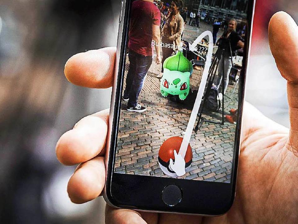 Im Spiel werden Pokémons in der realen Welt dargestellt.  | Foto: dpa
