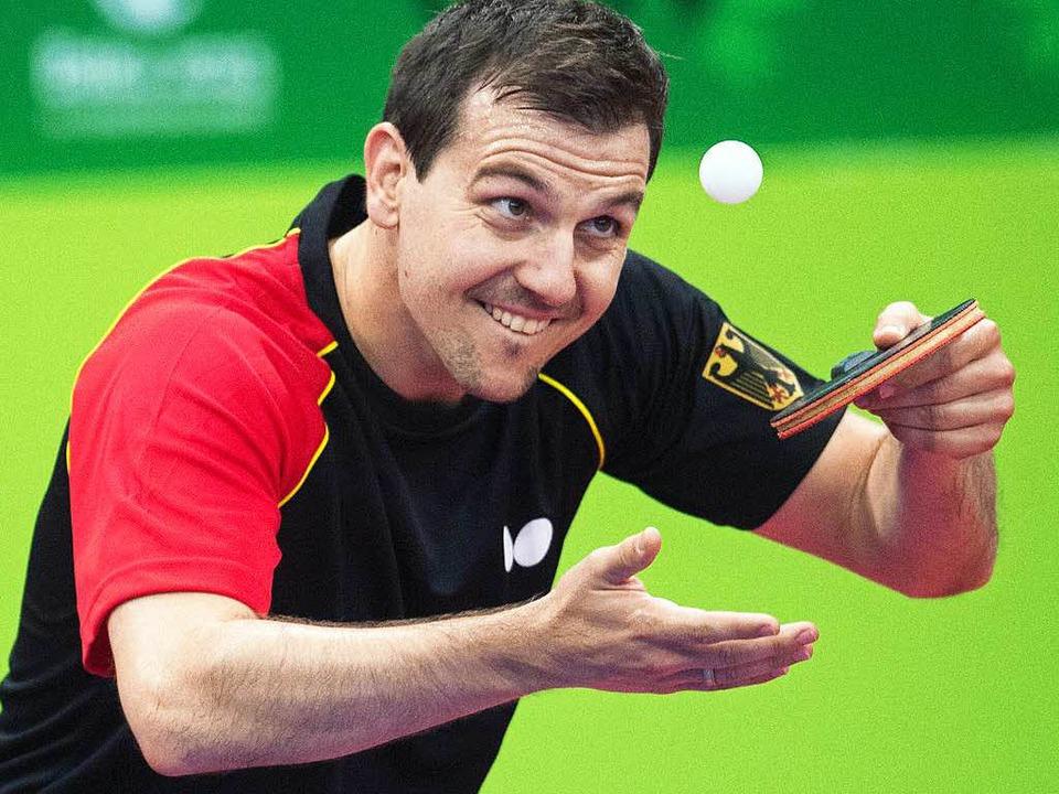 Der Herr des kleinen Balles darf bei d...o die deutsche Fahne tragen: Timo Boll  | Foto: dpa