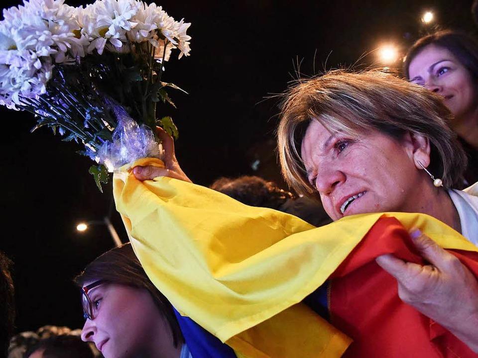 Freude in Kolumbien: Ein jahrzehntelan...utiger Konflikt steht vor seinem Ende.    Foto: AFP