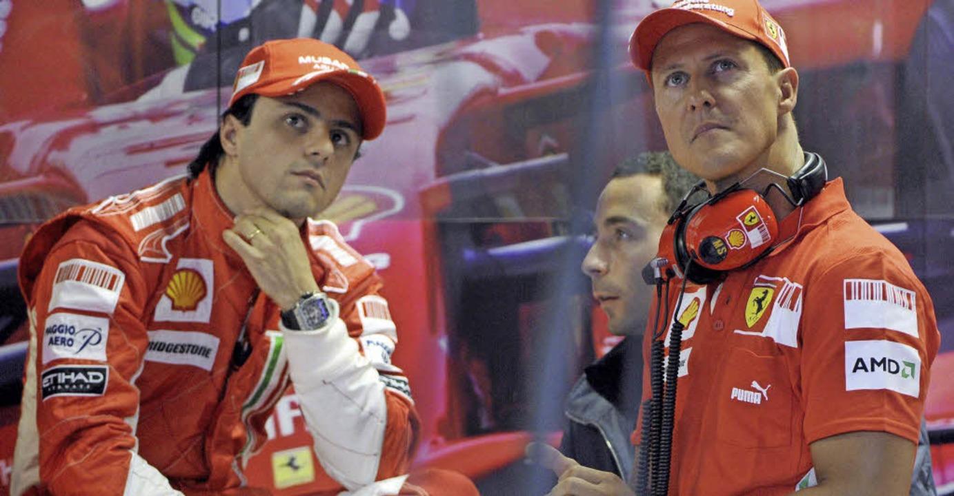 Felipe Massa nach dem knappen Titelren... rechts) vor dem Rennen am Wochenende   | Foto: dpa