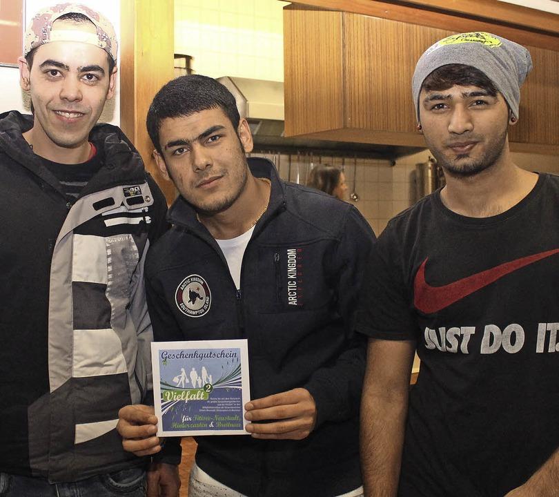 Amiri Hamza, Shershah Rasuli und Moham...ein vom Leistungsverbund für ihr Haus.  | Foto: Ute Kienzler