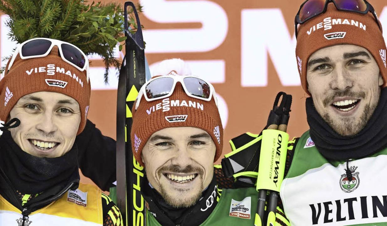 Nordische Dominierer (von links): Eric...el, Fabian Rießle und Johannes Rydzek   | Foto: AFP