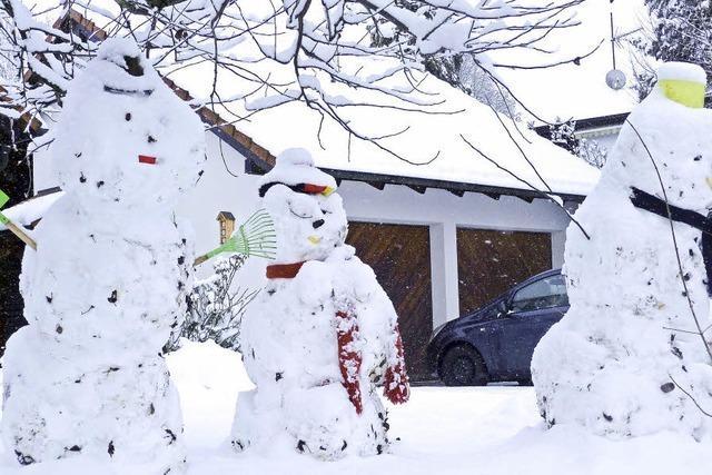 Drei Mann aus Schnee