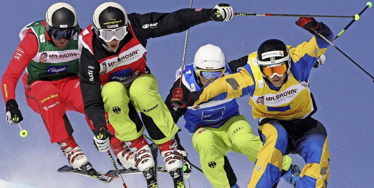 Spektakuläre Bilder – Skicrosser...des Jahres 2014 im russischen Sotschi   | Foto: DPA